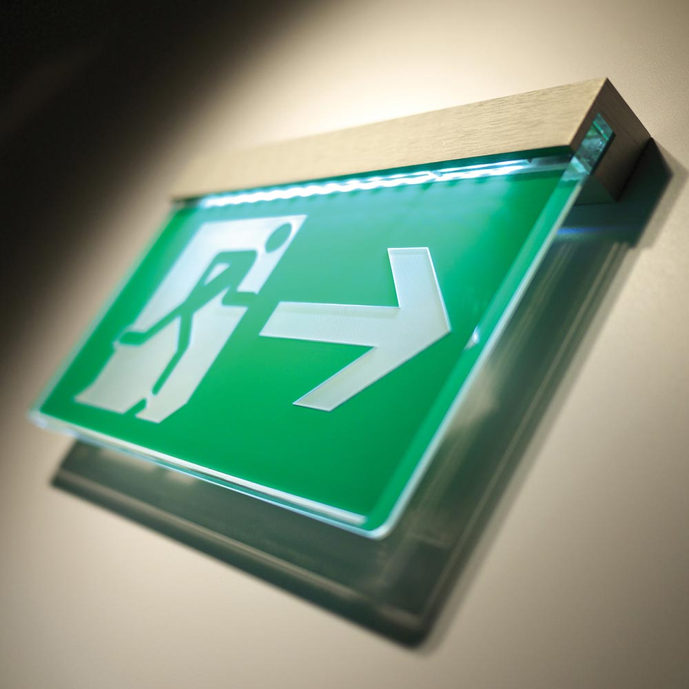 Illuminated directional signage