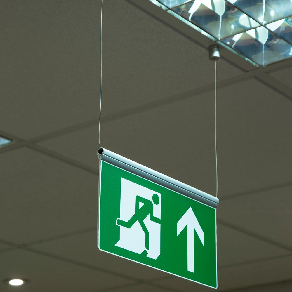 Ceiling suspended fire exit sign